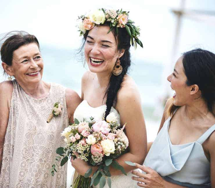 bride with bridesmaid and mother