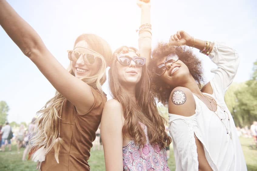 Three best friends at the music festival